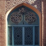 Friday Mosque of Shiraz, Iran Courtyard detail, metal doorway and tiled brick archway, north wing
