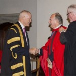 Chancellor Graham confers the honorary degree upon His Highness the Aga Khan as Professor Andy Orchard, former Provost of Trinity College, performs the hooding